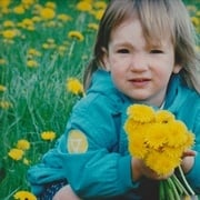 Lauren loved flowers at a very young age!