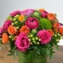 Hot pink roses with orange ranunculus and orange sweetheart roses