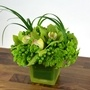 Green flower arrangement with cymbidium orchids and hydrangea