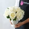 White peonies in a white vase
