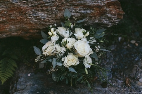 White and green bridal bouquet with eucalyptus